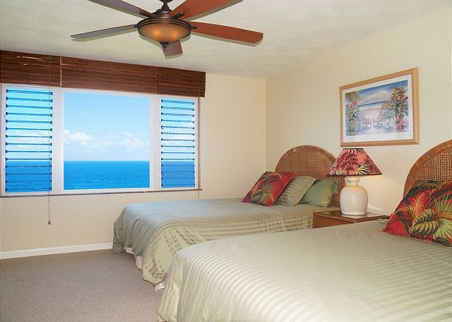 Second bedroom with two Queen beds and beautiful ocean view!