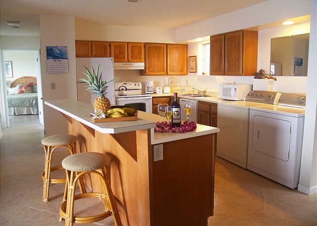 Recently updated kitchen and breakfast bar with seating for two.