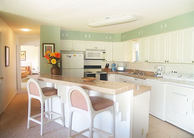 Sleek and modern fully equipped kitchen with breakfast bar for two