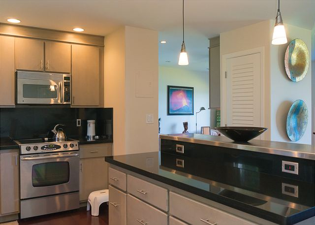 upgraded stainless steel and granite kitchen