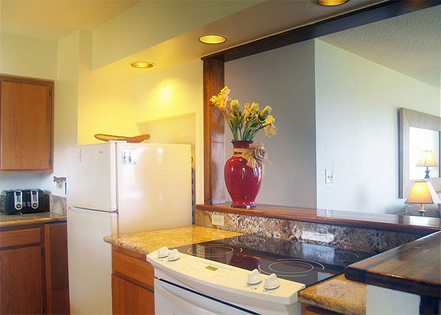 Kitchen with granite countertops and ocean view!
