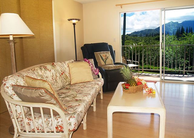Living room with jungle and mountain views.  Top floor condo!