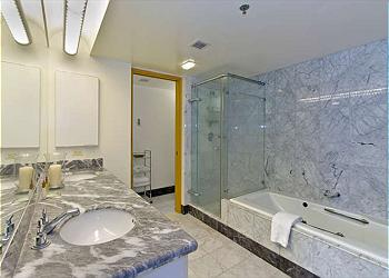 Master Bath with Jetted Tub and Marble Tile