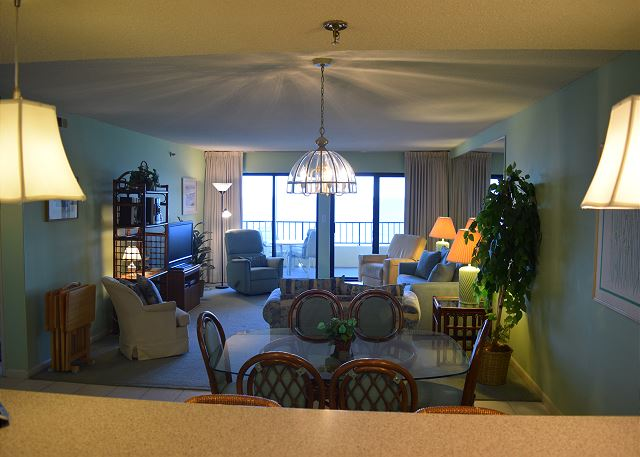 Looking from the kitchen to the beach front balcony.
