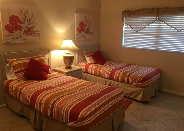 Two twin beds in the guest bedroom.