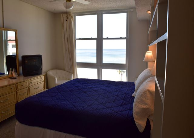 King bed in this room and beach outside the window.