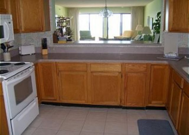 Large fully equipped kitchen that looks through to the living space.