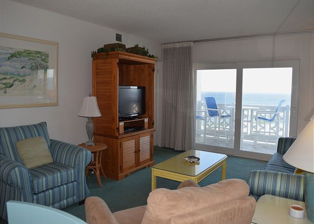 You have a new flat screen television or high chairs and table on the balcony to watch live.