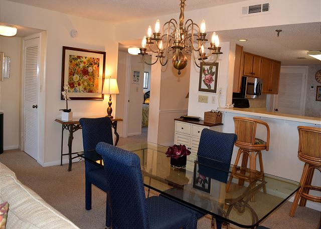 Dining, kitchen, guest bedroom and bath, entry to master... all in this picture.