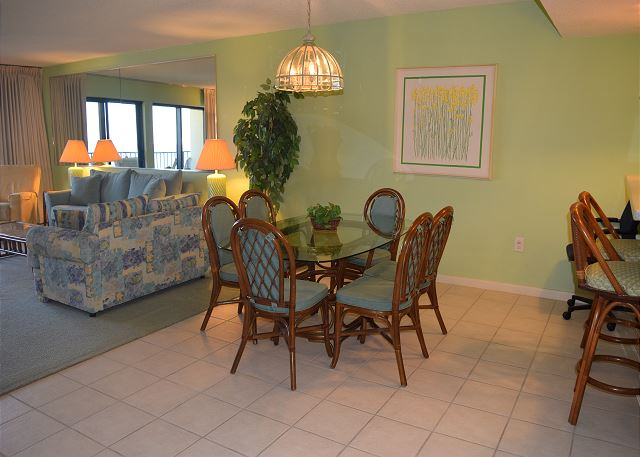 Dining room is between kitchen and living area, has a tile floor - makes cleaning up simple.
