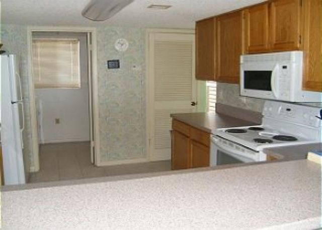 Large fully equipped kitchen with seperate laundry room.