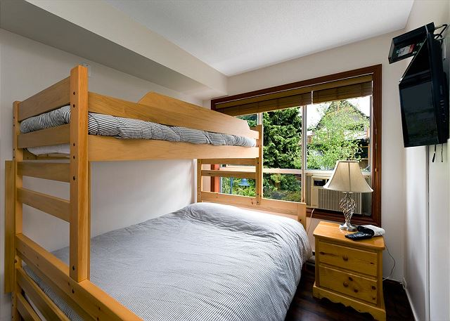 All of our homes have a queen bed and a pull out couch, this home also has a double / twin bunk!