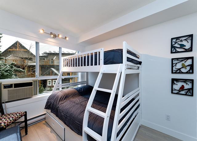 The second bedroom has a bunk bed with a double below and a single on top.  There is also sleeping for two in the living room.