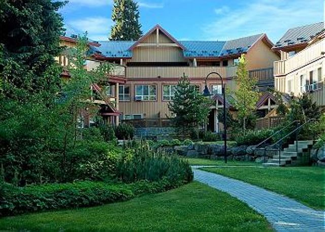 This inner courtyard at Glaciers Reach is great for kids to play, grass in the summer & snow in the winter.