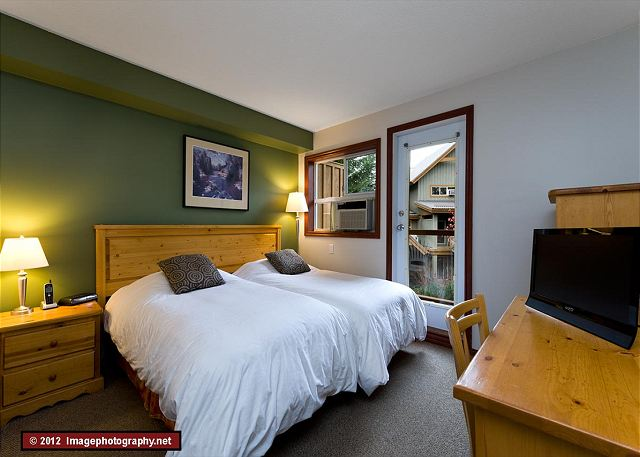 This room has two twin beds that can be joined to make a king upon request.  It also has a ensuite bathroom, TV, walk through closet and dresser.
