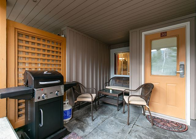 Front patio has a BBQ grill and a patio furniture set
