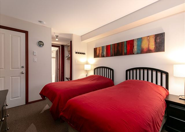 This bedroom has access to the en suite bathroom and has two twin beds that can be joined to make a king upon request.