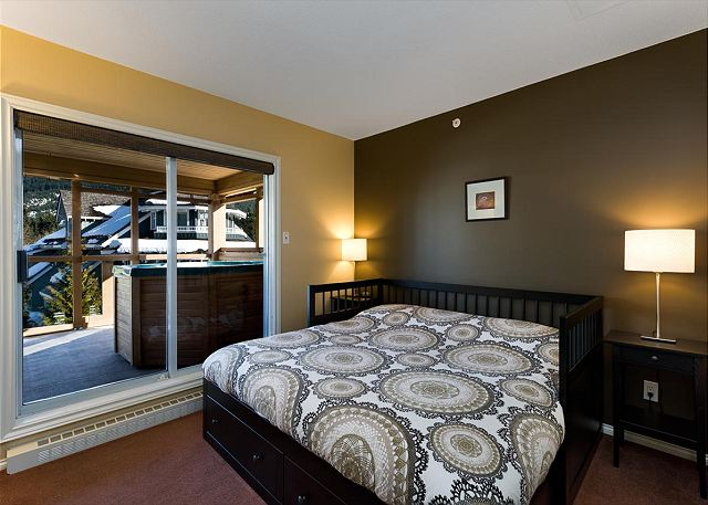 Queen bed and a private hot tub on a secluded third floor deck with amazing views of Whistler and Blackcomb mountains.
