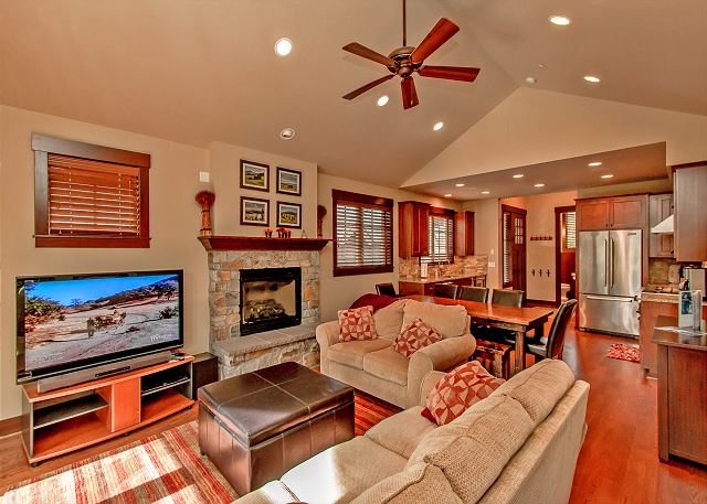 Comfortable living room with a large flatscreen and a gas fireplace!