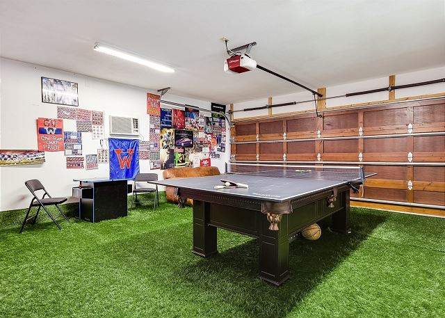 Enjoy this turfed game room with darts, billiards, ping pong, and other games!