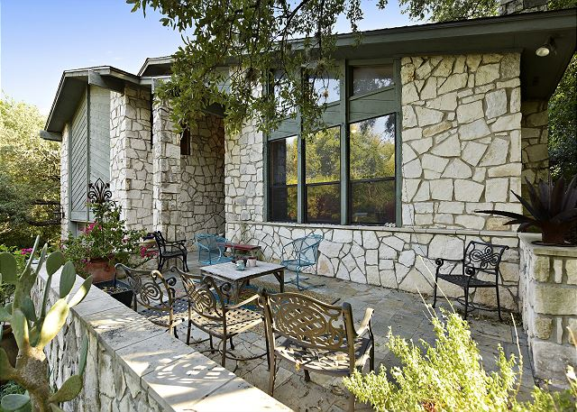 Front porch where you can enjoy your family/friends company while the kids play basketball or games in the front yard