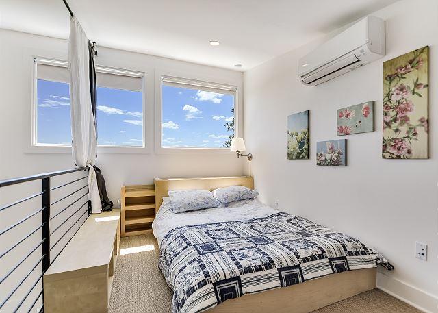 Whimsical upstairs loft queen bedroom in casita