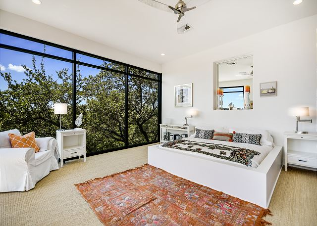 Master bedroom that looks out over the pool and has the ability to add multiple front gate beds