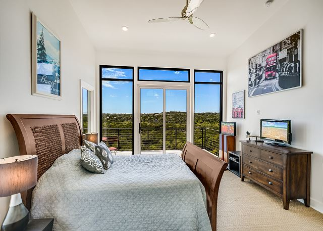 Upstairs queen bedroom with private balcony