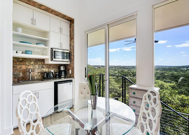 Cozy dining room and kitchenette located in on property casita