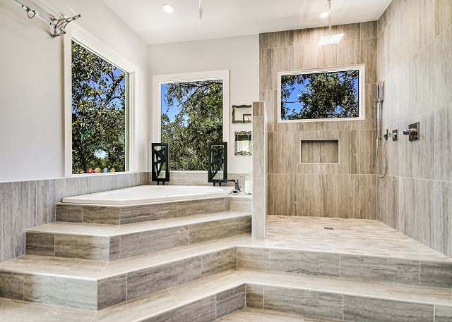 Open shower and soaking tub in master bathroom