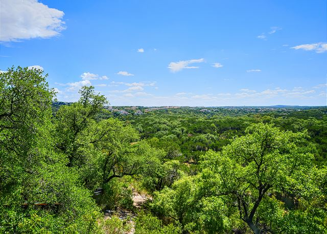 Gorgeous view of the lush hill country with hiking trails accessible from the property