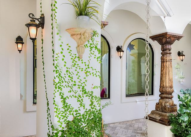 Greenery creeps up the walls of this serene rock garden
