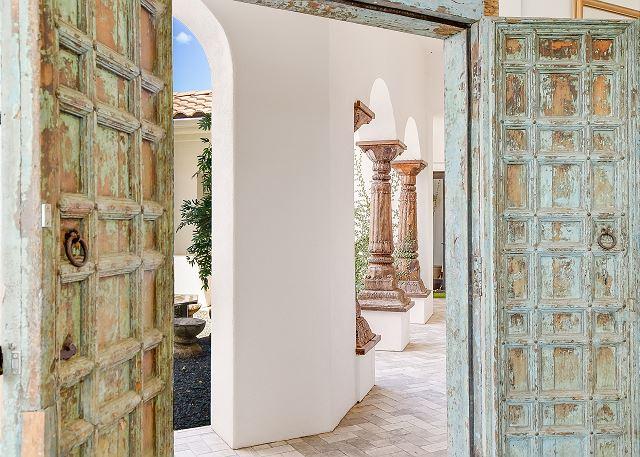 Lavish doors make way to the beautiful rock garden entryway