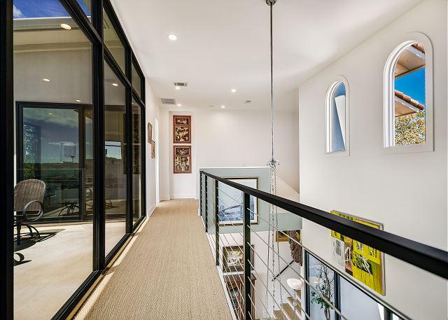 Walkway between master bedroom and queen bedroom