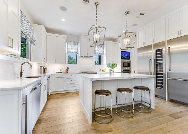 Share a meal in this roomy kitchen outfitted with top appliances.