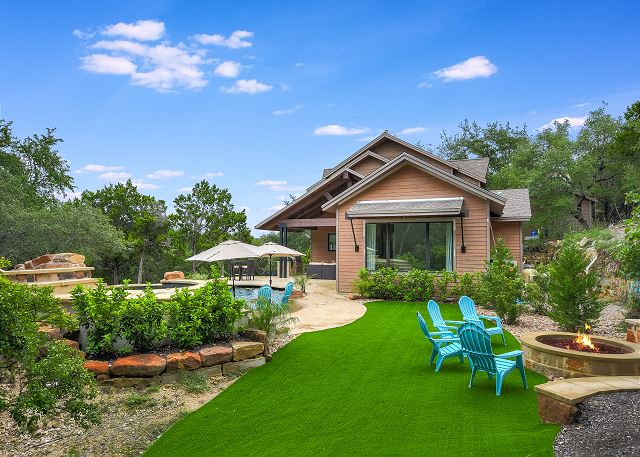 Beautiful backyard scenery; enjoy visiting around the fire pit while the kiddos enjoy the pool