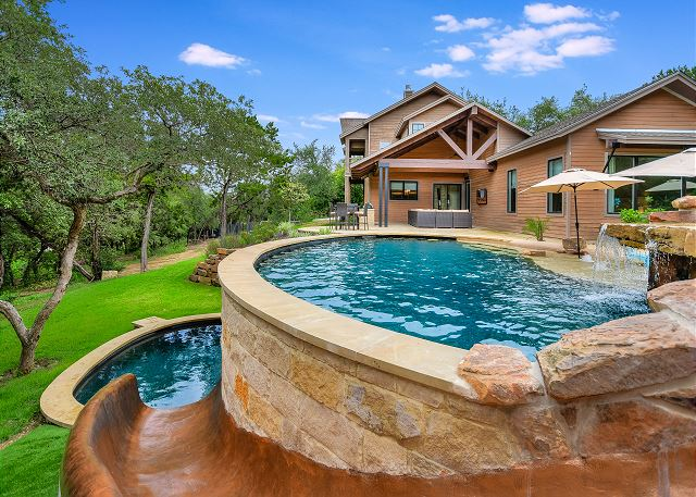 Slide into fun and adventure with family and friends in this multi-level pool