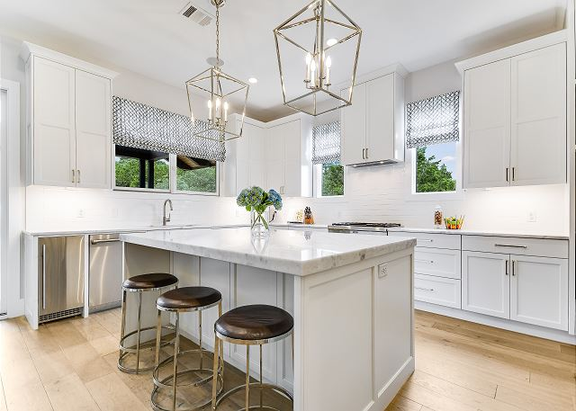 Enjoy this beautiful kitchen with top appliances for guests to cook a delicious meal, or spacious enough to have a catered event.
