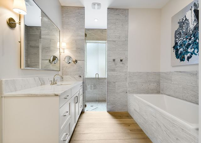 Beautiful master bathroom with stone detail