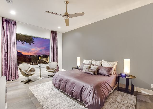Enjoy the trademark Skyline View from this second story Master Bedroom.