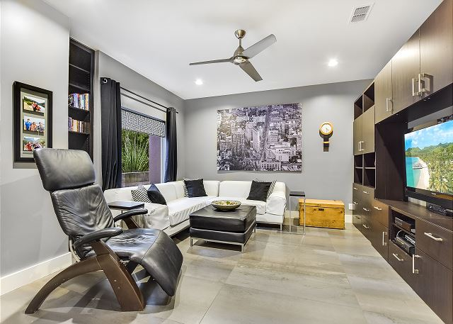 Enjoy this cleverly designed media room with just enough privacy.