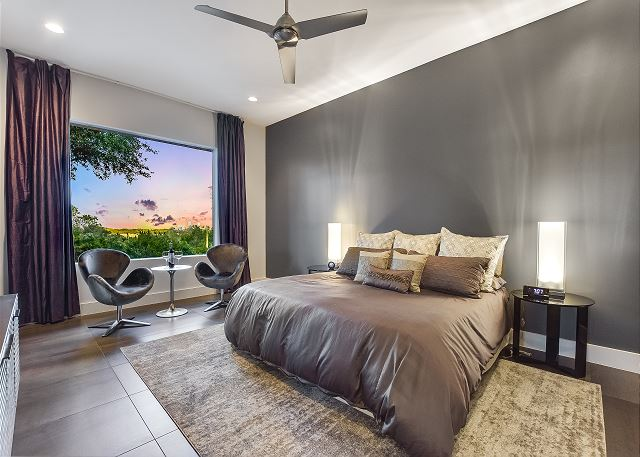 The Master bedroom has an exclusive view of the Austin skyline!