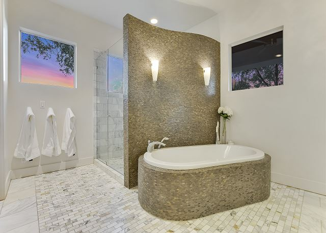 Take your pick between a spacious shower or inviting bath tub.