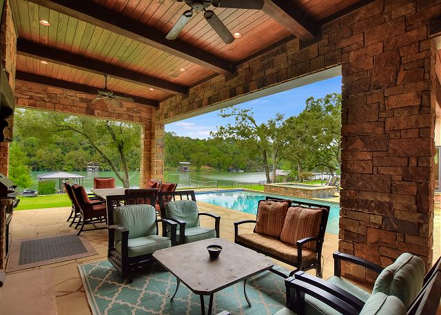 The outdoor living area is the perfect place to enjoy the company of your group while swimming in the pool or lake, playing soccer, basketball, or sand volleyball