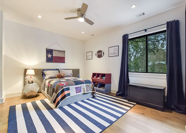 Enjoy this queen room with lots of space.
