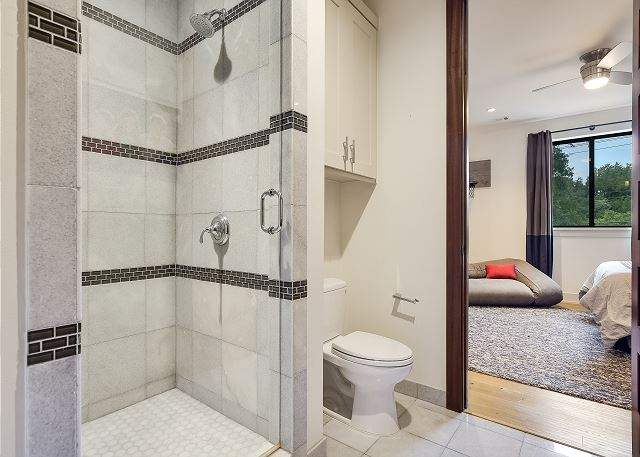 Full bathroom attached to a bedroom.