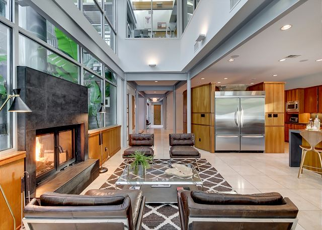 Spacious living area with indoor/outdoor fireplace