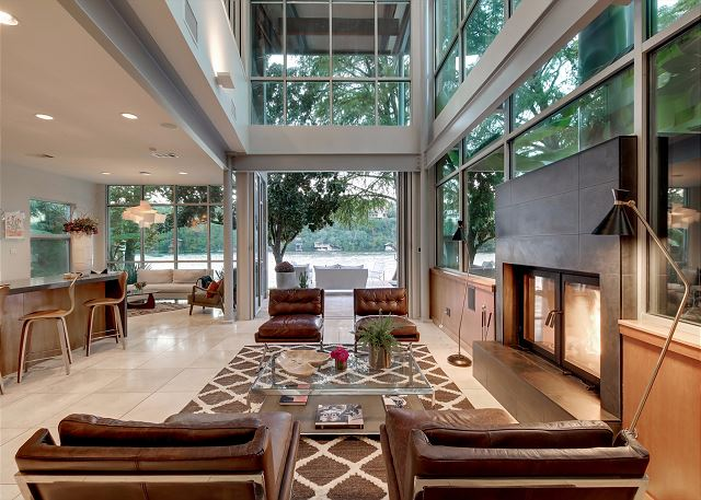 Spacious living room with large glass sliding doors that fully open creating a beautiful indoor/outdoor living area