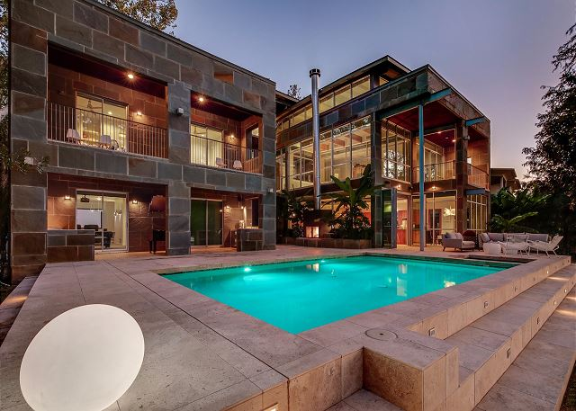 This wonderful pool and backyard has endless possibilities. You can play pool volleyball, corn hole in the yard, or just lounge by the pool and BBQ!