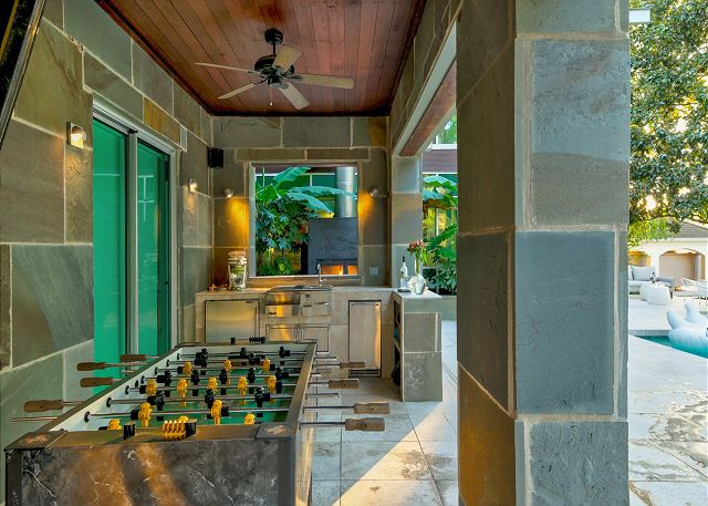 Grill out and play a round of foosball in this outdoor kitchen area